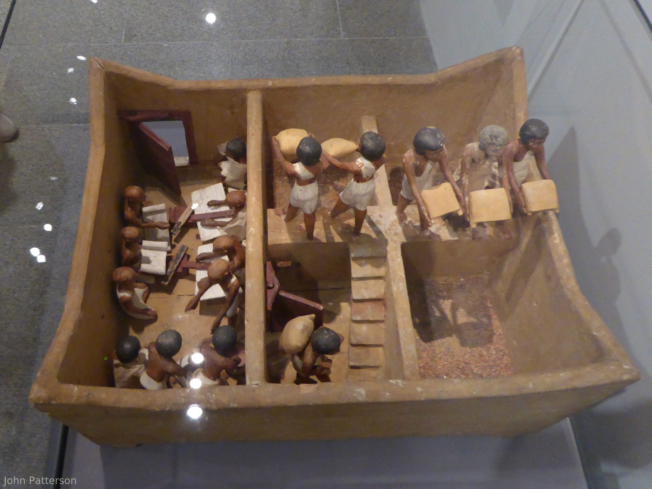 A photo of a tomb model of a granary from the Middle Kingdom tomb of Meketre in the Met Museum
